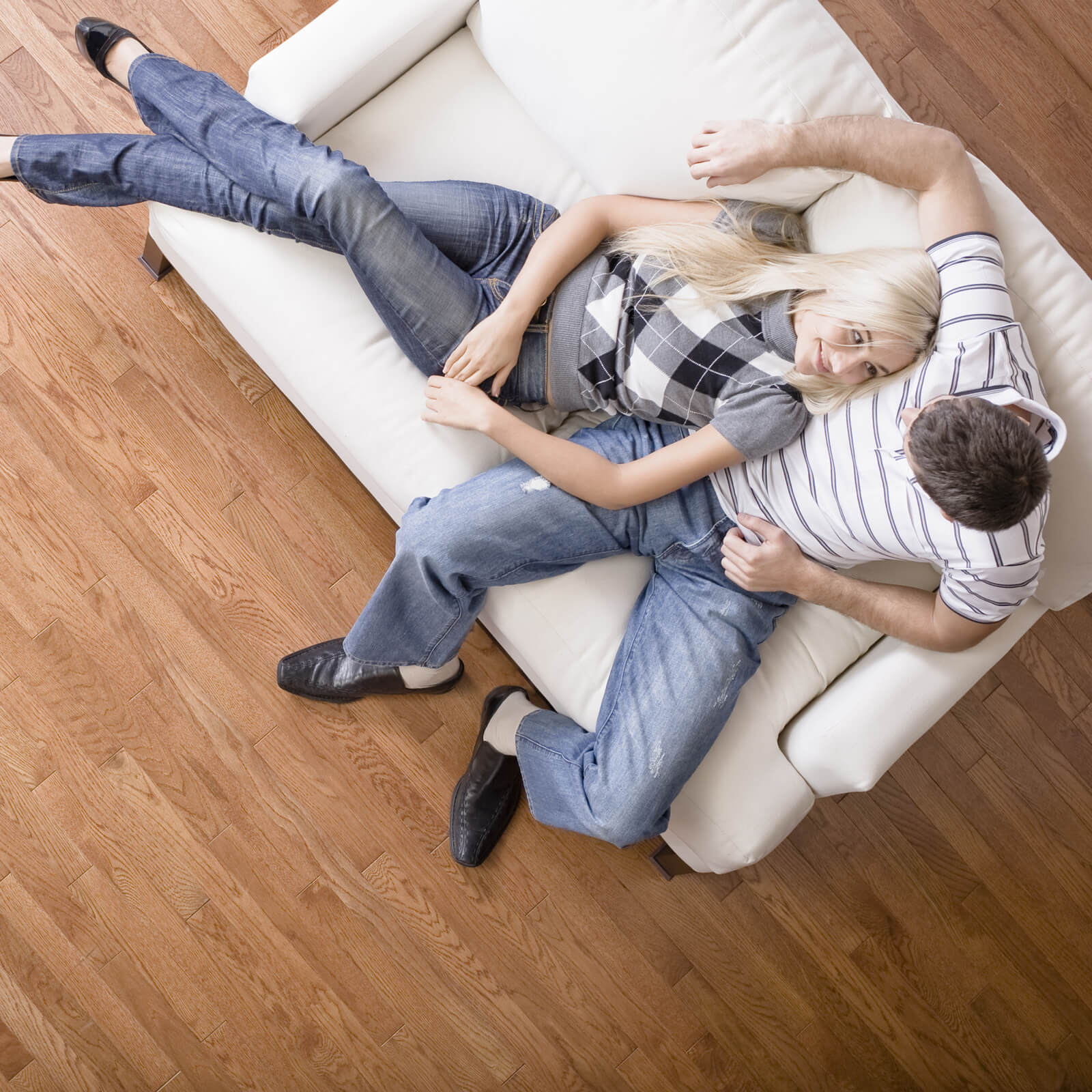 Couple sitting on sofa | Floors by Roberts