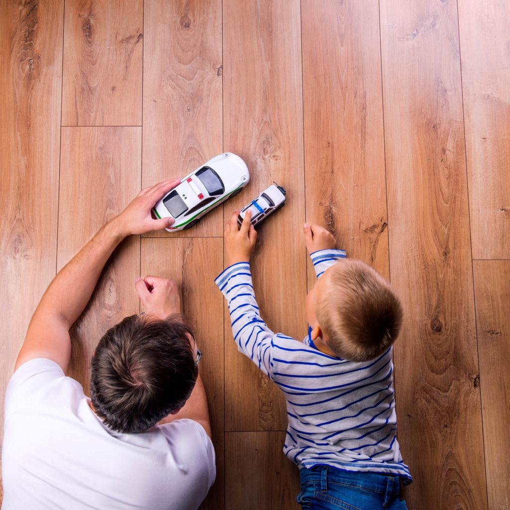 Father and kid playing with toycar | Floors by Roberts