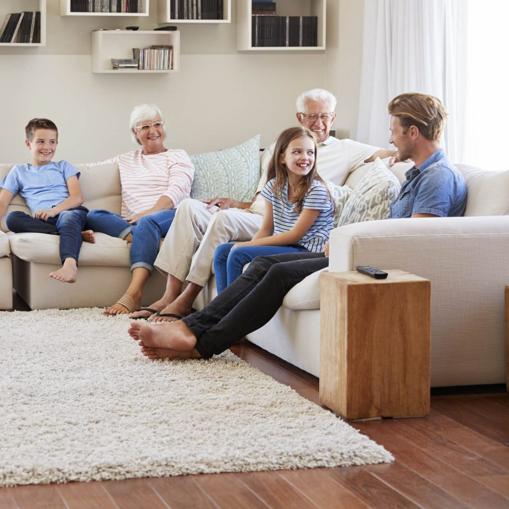 Family gosping in living room | Floors by Roberts
